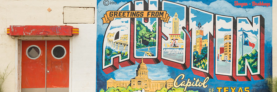 greetings from austin mural on building