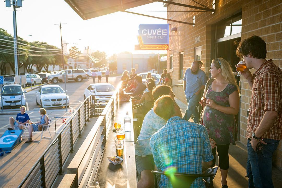 a group of customers on cuvee coffee's patio bar