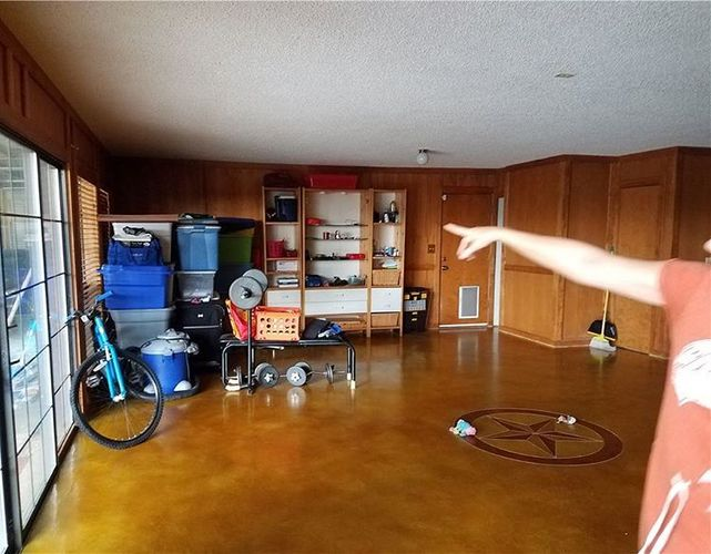 worst mls photo man pointing to corner of house